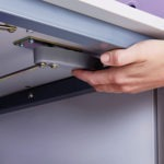 Separate power compartment opened with a concealed handle
